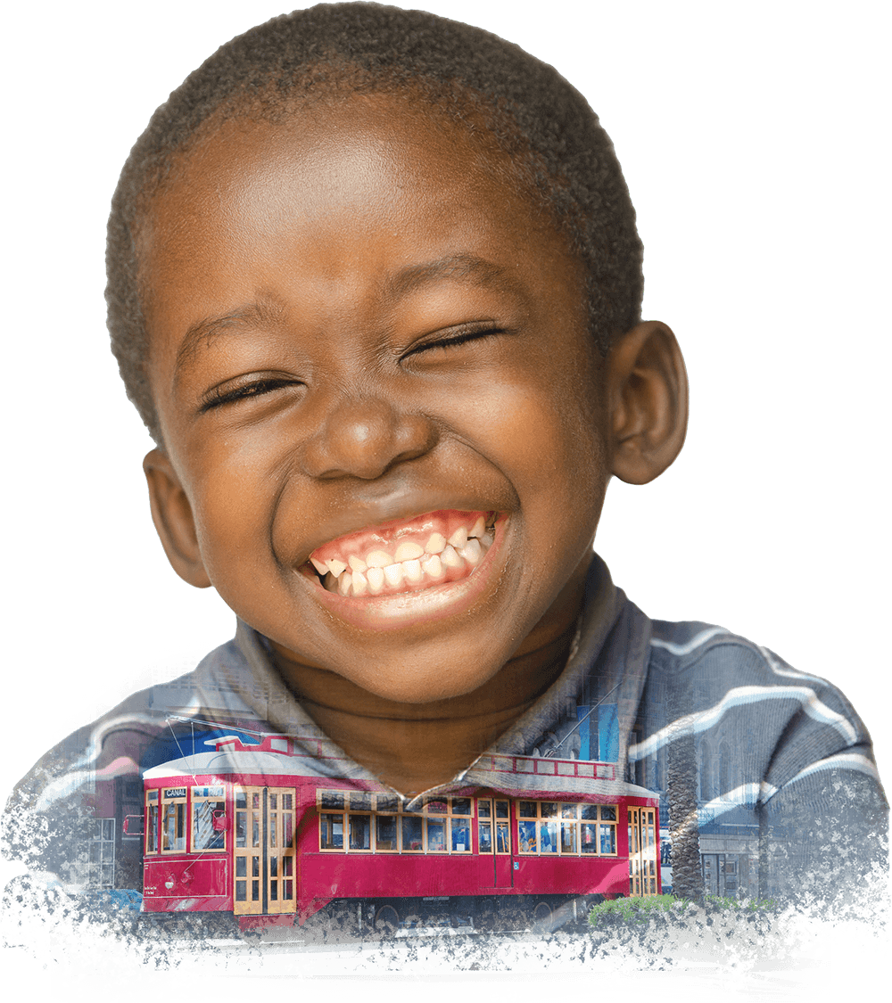 Collage of a little boy with a huge smile, laughing hard and a New Orleans streetcar traveling down Canal Street.