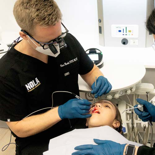 Kristoffer Norbo DDS, MSD working on patient