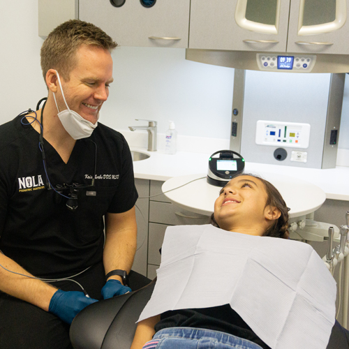 Kristoffer Norbo DDS, MSD talking to patient