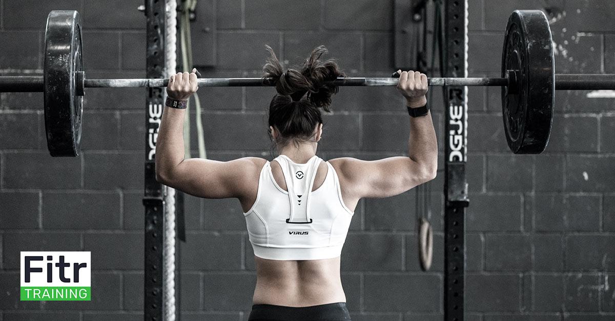 Barbell Shoulder Press In A Gym