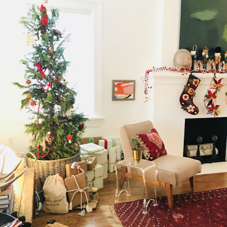 This living, potted Christmas tree was styled in a bright and airy mid-century modern look by a Green Tree Project residential client. It's one of our favorite looks!