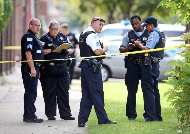 Chicago police officers at a south side crime scene