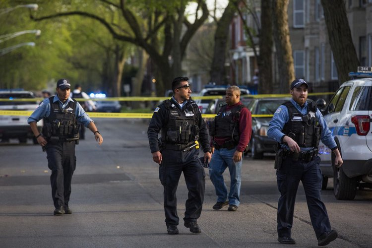 Chicago police officers securing a crime scene