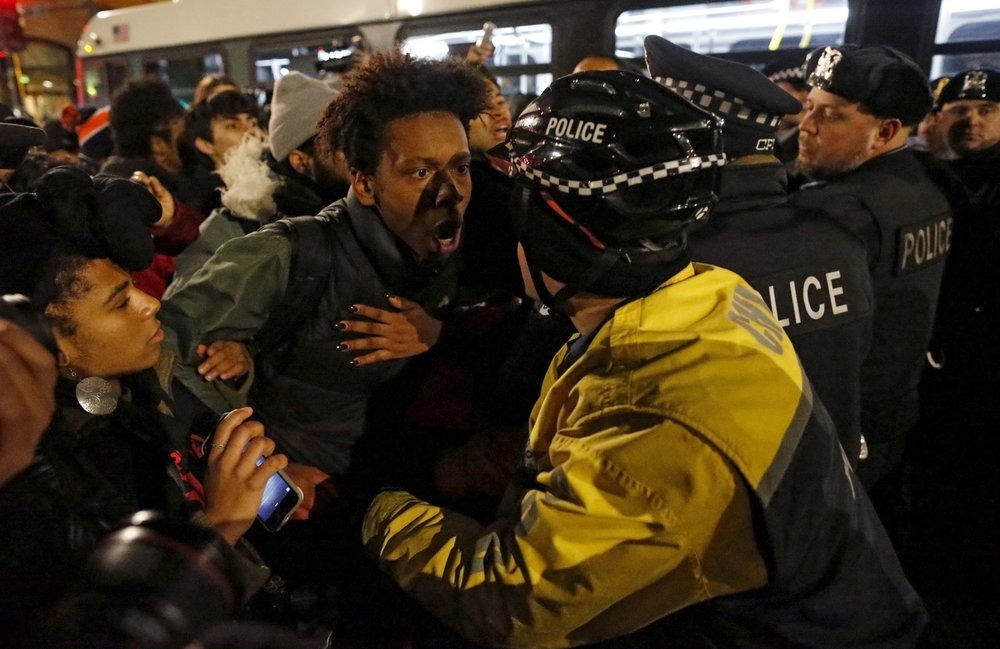 Anti-police demonstrators confront Chicago police in November 2015
