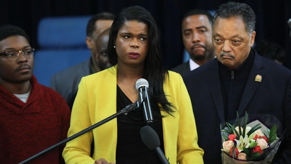 Cook County State's Attorney Kim Foxx flanked by anti-police agitator Ja'Mal Green and the Reverend Jesse Jackson