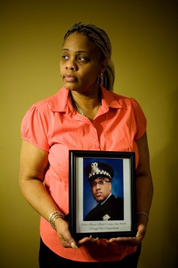 Tamara Tucker holding a photograph of her late fiancé, Officer Clifton Lewis