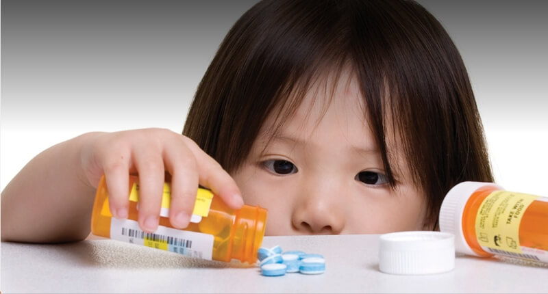 Toddler playing with pills.