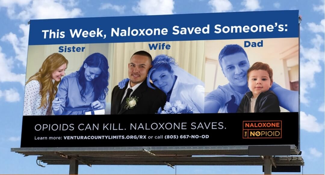 Naloxone billboard with sister, wife, and dad.