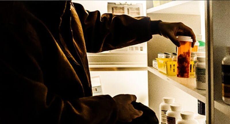 Man storing medicine safely.