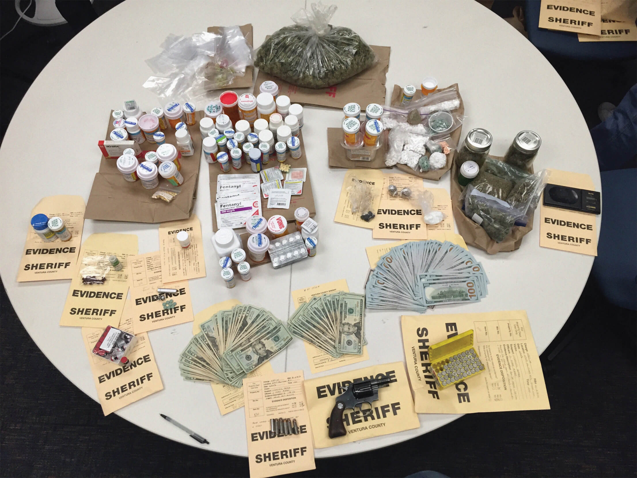 Paraphernalia collected as evidence on table.