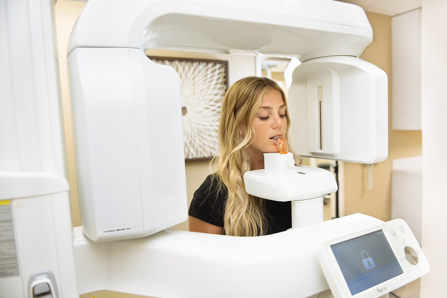 patient getting x-ray from high-tech machine