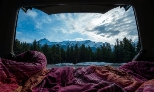 The scenic view from the bed out of the back of a converted campervan