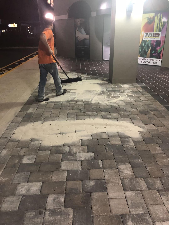 men repairs paver sealing