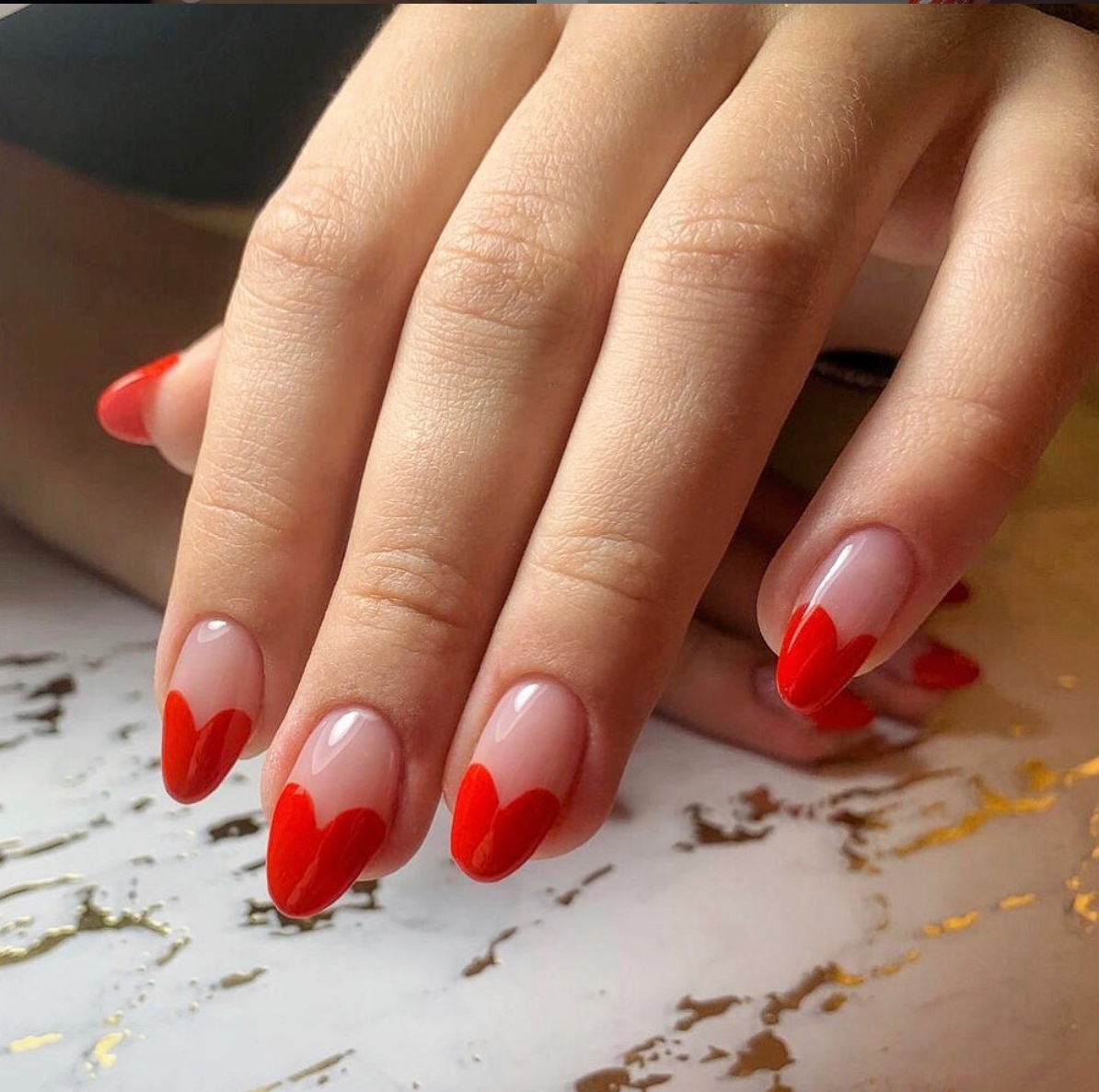 Red oval acrylics