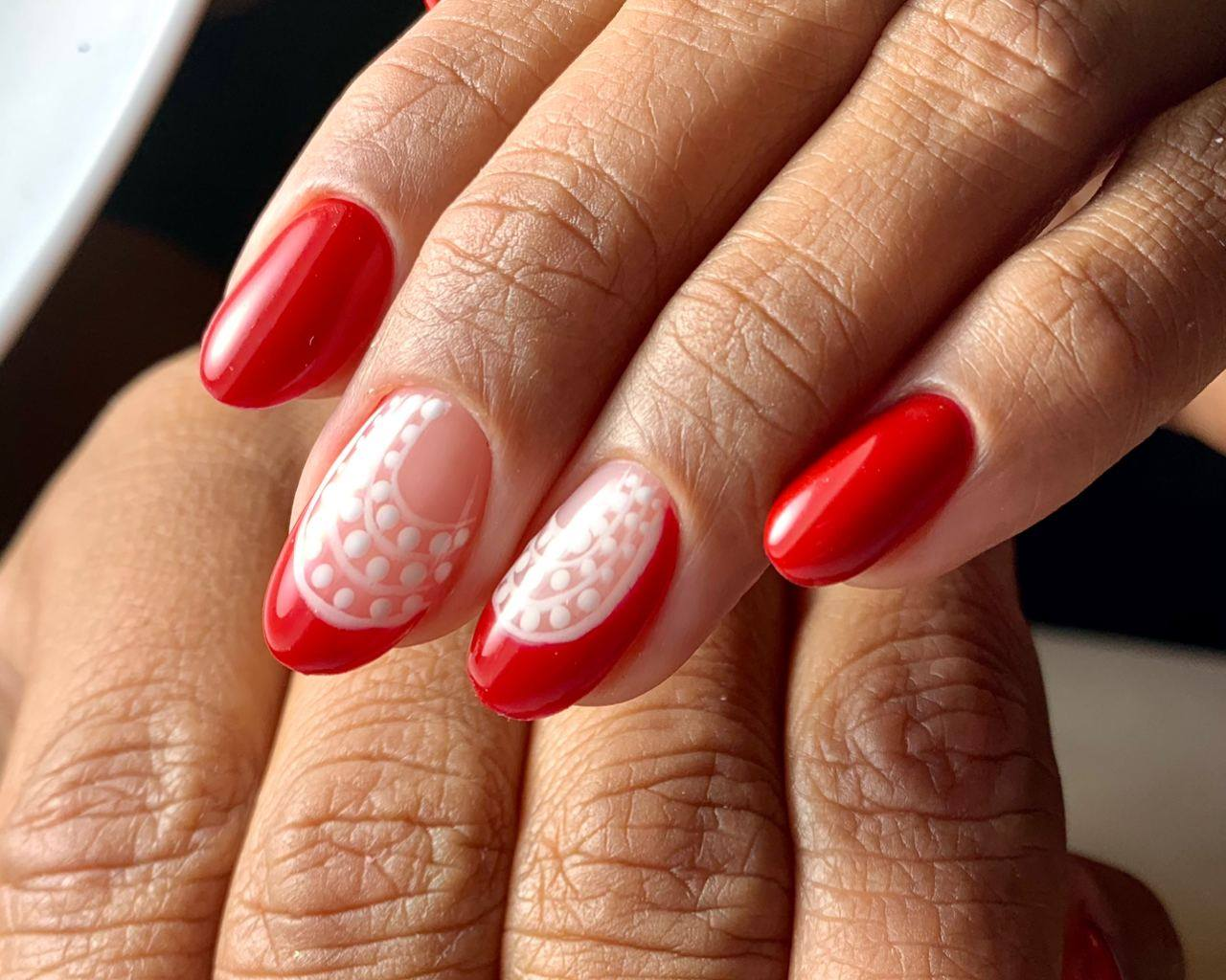 Red Nails with White Design
