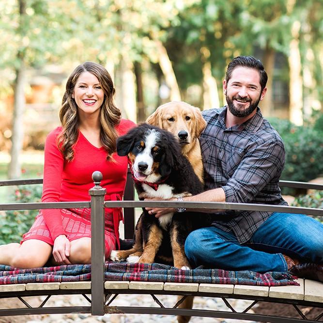 dr. alex, husband and dog sitting outside
