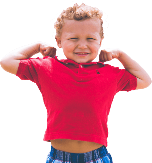 little boy flexing his muscles and smiling