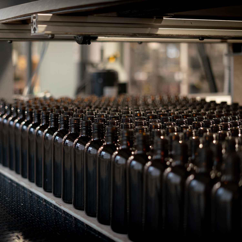 Empty bottles on drink line at FedUp Foods