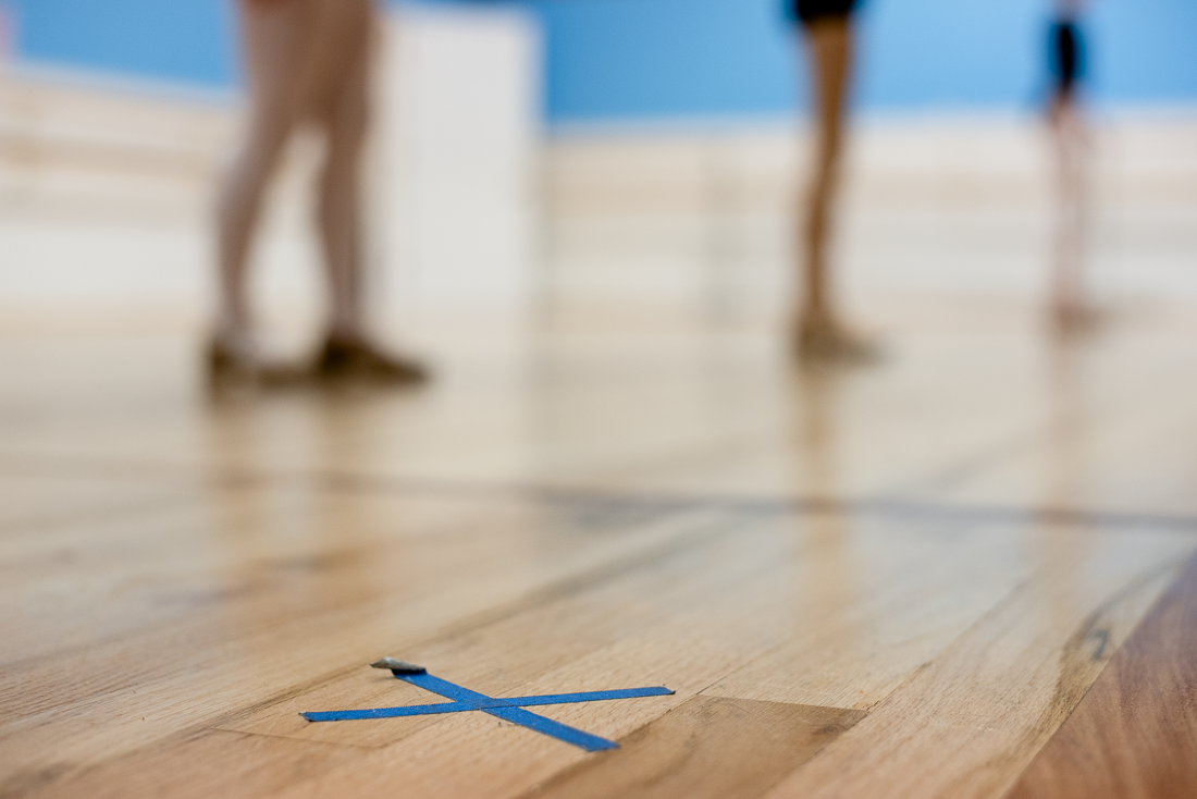 X's on the floor mark where dance students should stand to stay six feet apart