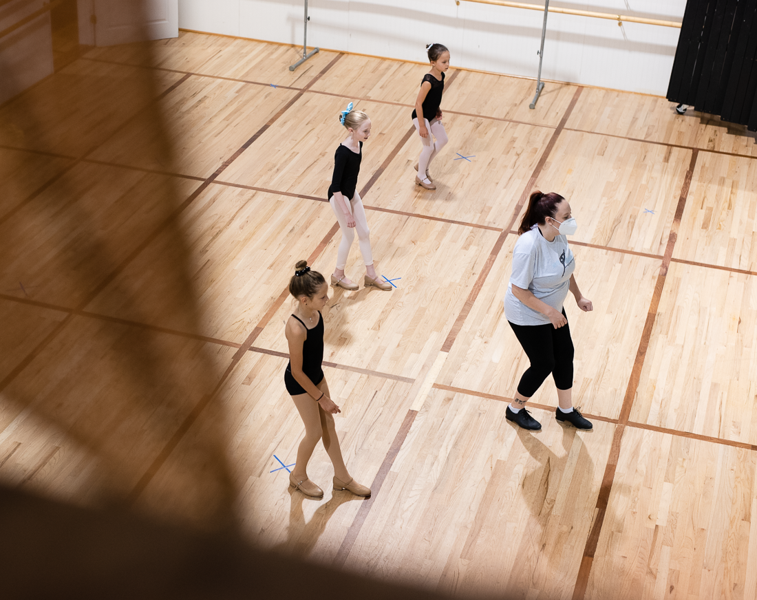 Group of young tap dancers and their teacher in class