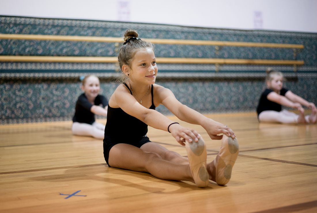 Young girl stretching in the dance studio