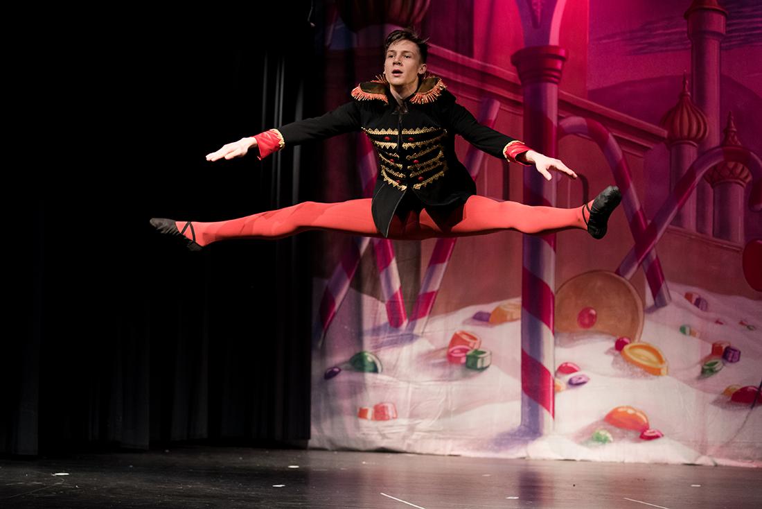 Male ballerina doing center leap.