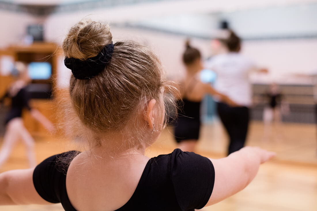 A young dancer prepares to turn.