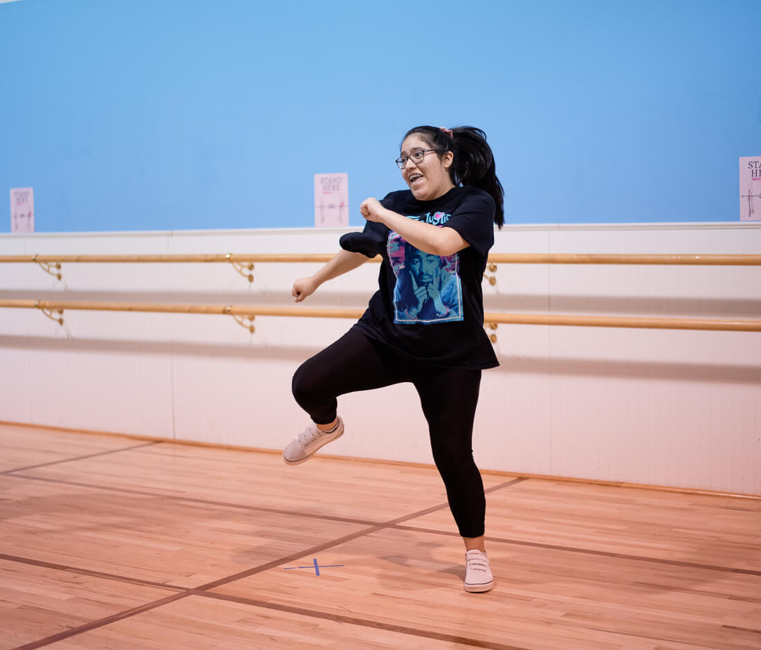 A dancer is learning a hip hop routine at the dance studio.
