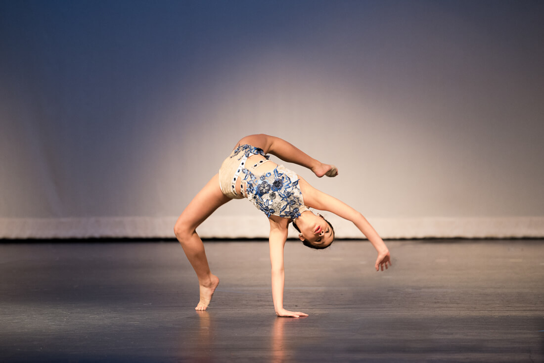 Young dancer performing a tumbling move