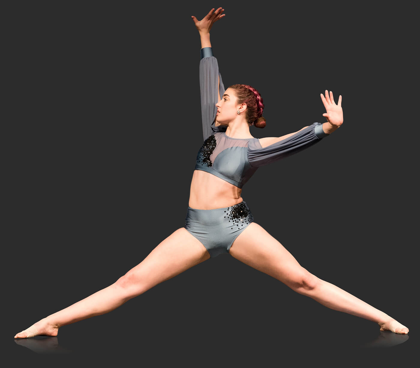 Dancer posed in a half split