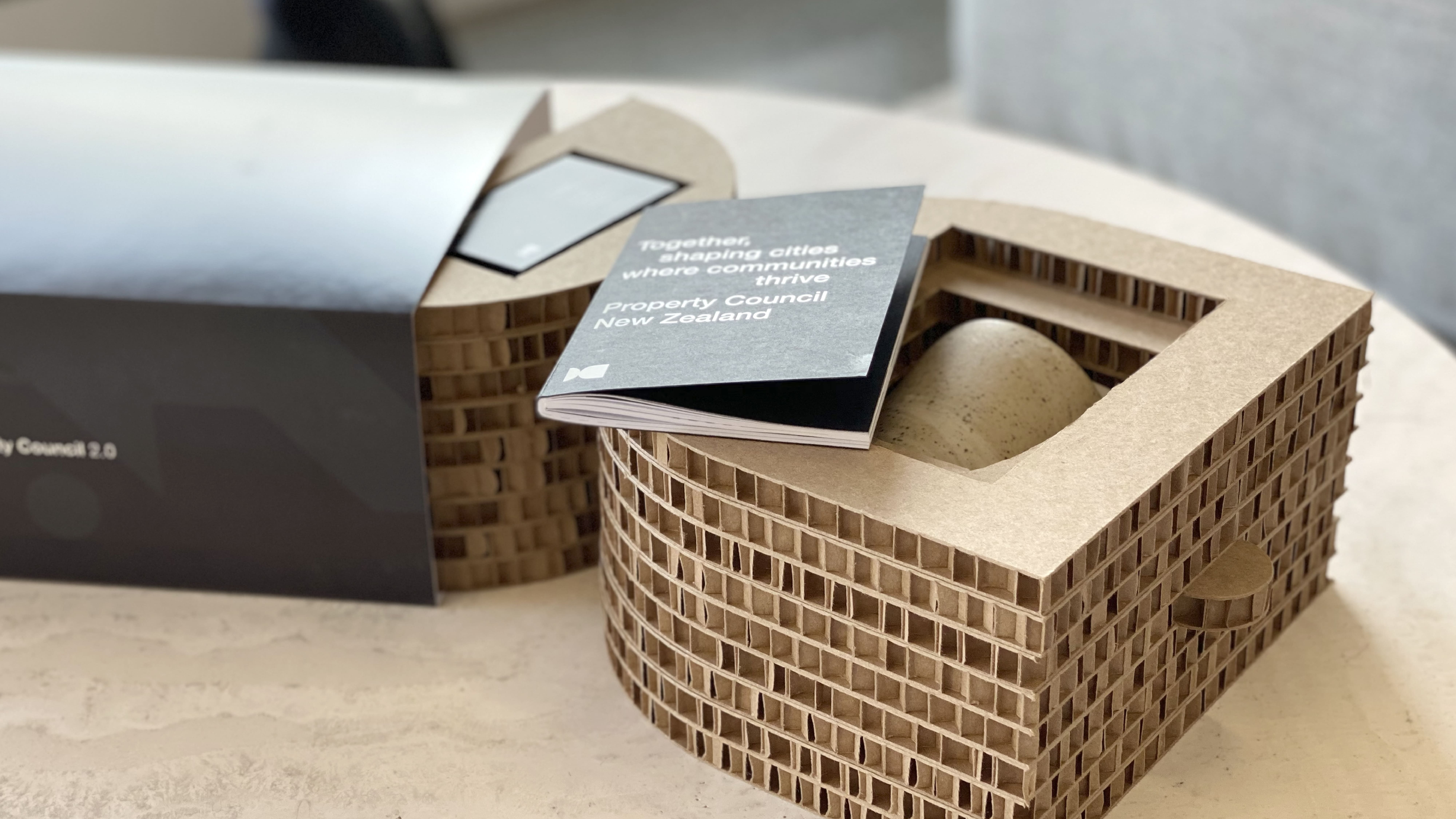 attraction studio pcnz brand environmental packaging on table