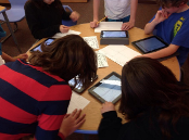 Students working on iPads