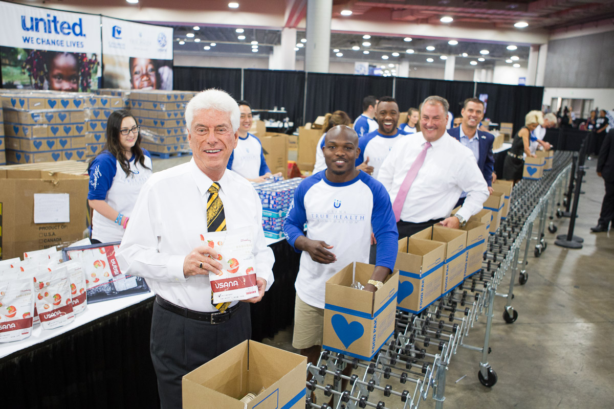 Dr. Wentz and USANA volunteers packaging relief goods at a humanitarian event
