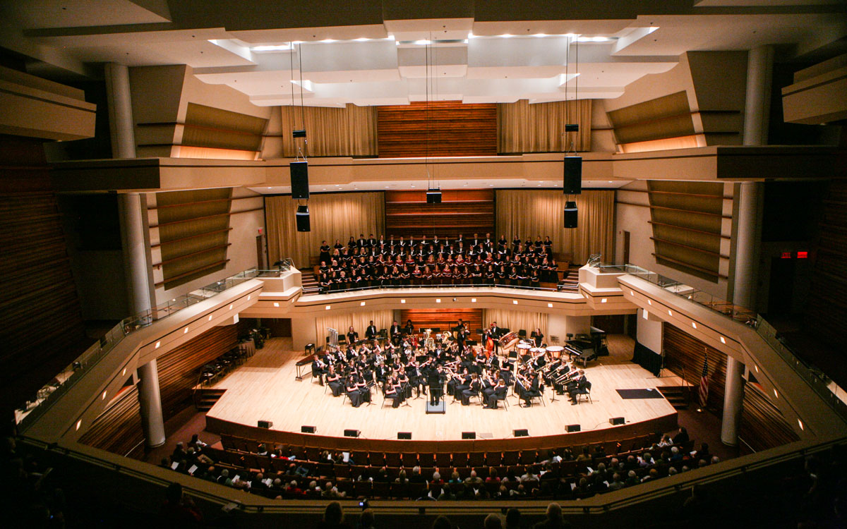 a photo of an orchestra and choir performing at the Wentz Concert Hall