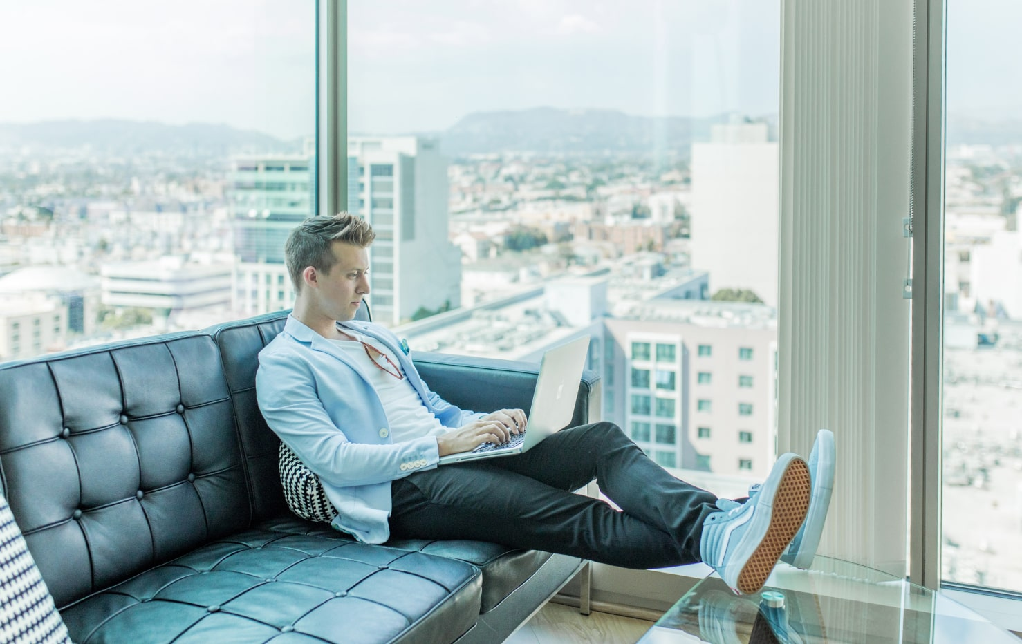 Man in office sitting on sofa