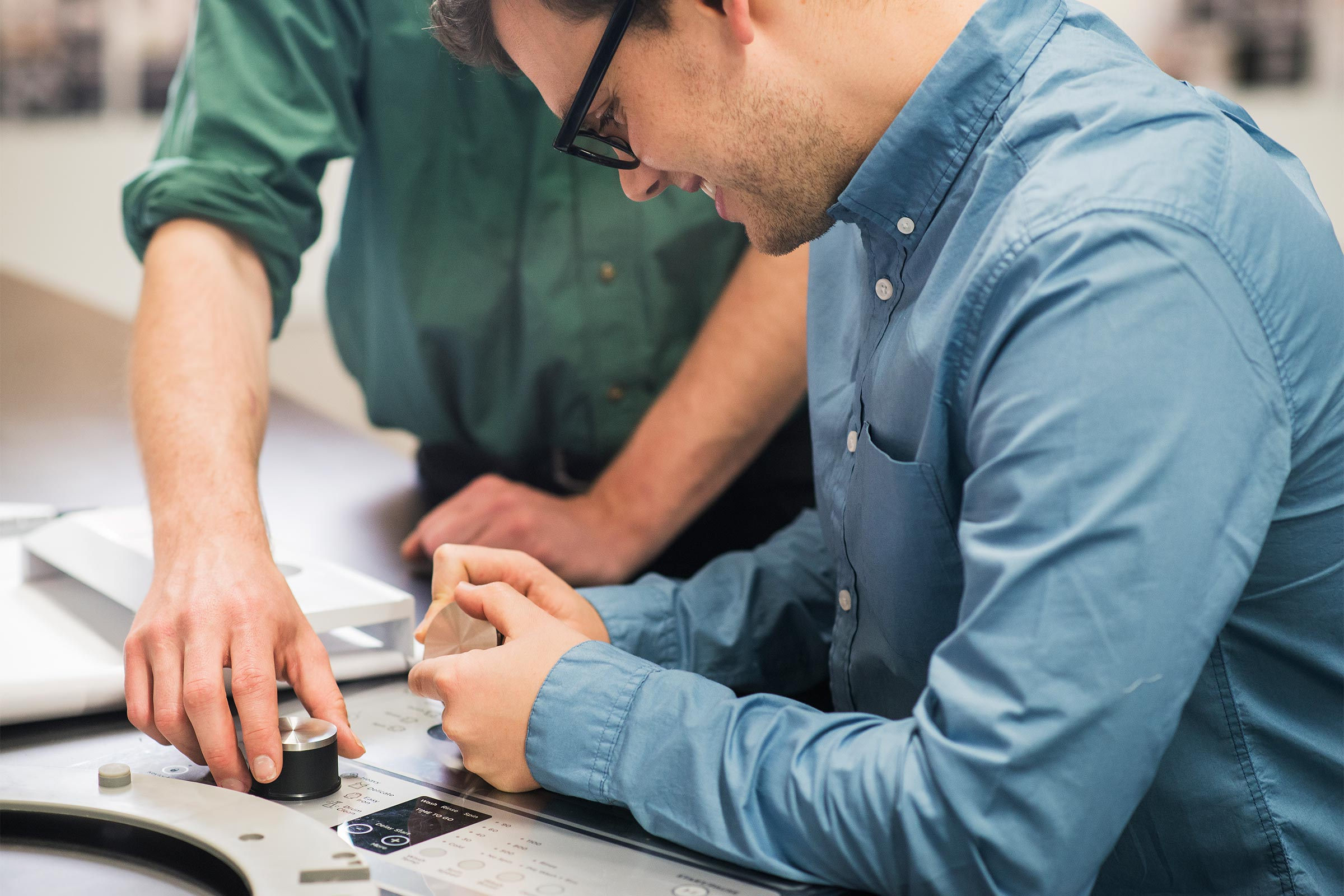 Two men working on a healthtech prototype