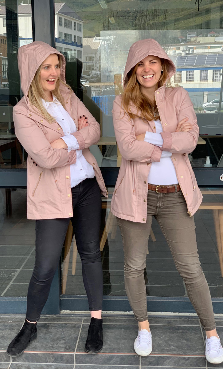 Team members Tegan and Mri being twinsies with the same jacket.