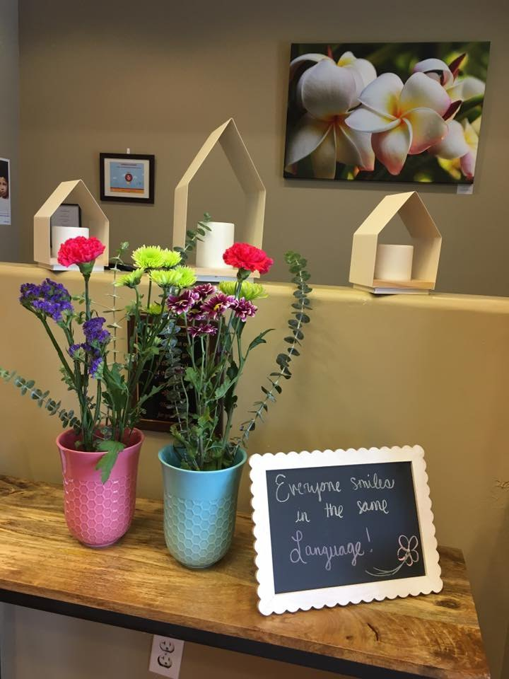 front desk with flowers and paintings