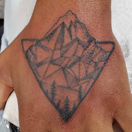 tattoo-of-mountains-on-hand