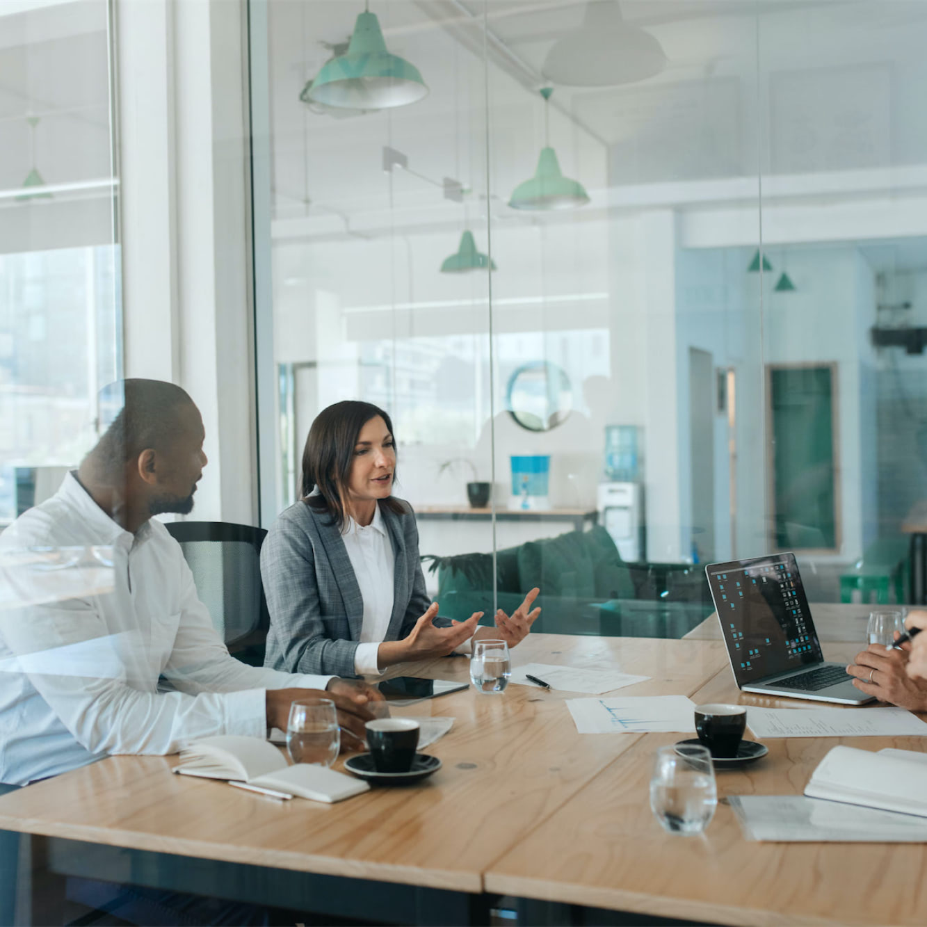 Business team discussing work around a table