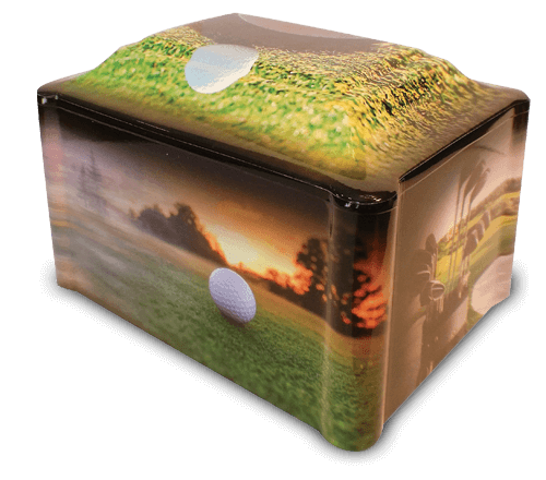 One of our most popular vinyl-wrapped urns, Hole-In-One, captures the joy of the game of golf. The main side shows a ball on the green at sunset just waiting for that final putt. The various images present a beautiful course featuring a water hazard, a set of golf clubs and a pair of golfers walking to the next hole. The top design of the urn shows a golf ball just about to fall into the cup for that coveted hole-in-one shot.
