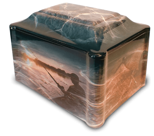 Our Last Catch vinyl-wrapped urn is truly a fisherman's delight! The main design shows our fisher at his favorite lake spot right at sunrise. The opposite side shows a large mouth bass on the line and the smaller sides showcase a well-loved tackle box and favorite lure. The top of the urn's design is of crystal clear water.