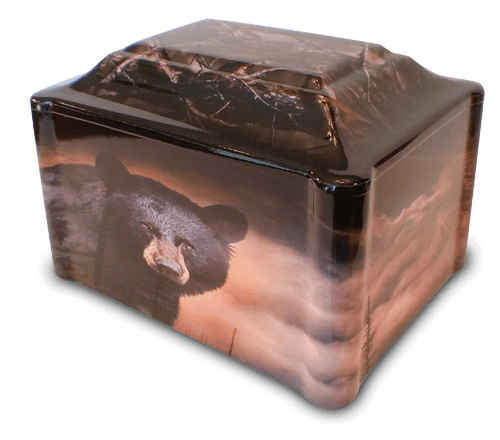 The glory of nature can never be overstated! Our Nature's Retreat vinyl-wrapped urn captures the essence of nature's mighty power with a beautiful image of a black bear on one side and a young buck standing in a meadow on the opposite. Large billowing clouds decorate one end while the opposite end and top display the thick branches of the forest.
