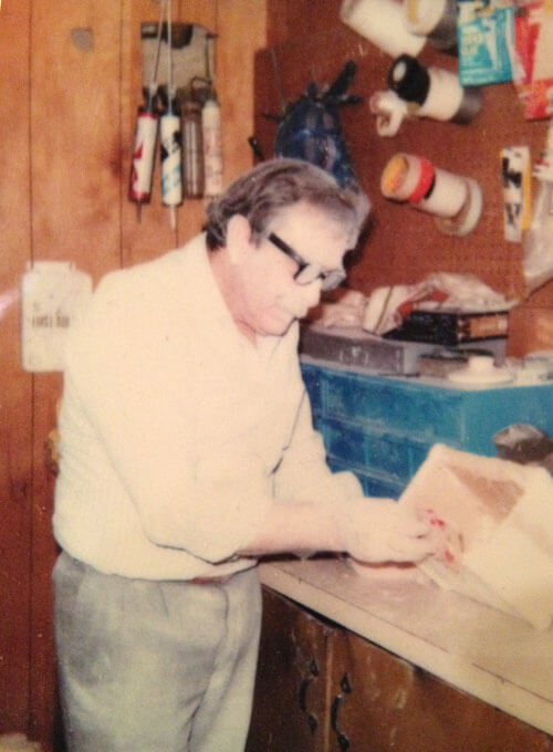 Founder Henry J. Roy putting the final touches on the original Dynasty Urns urnmold in his workshop.