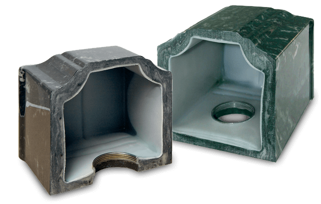 Two single urns cut in half to show how thick they are that they are a seamless construction