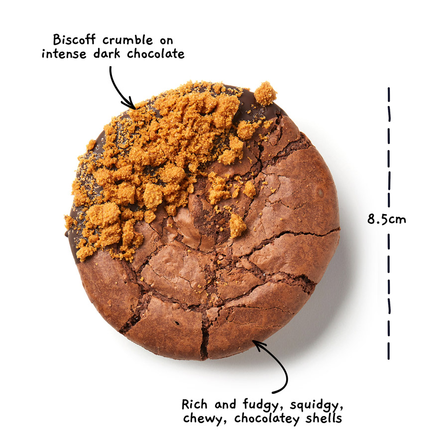 Image of a biscoff brownio from above with the words Biscoff crumble on intense dark chocolate. Rich and fudgy, squidgy, chewy, chocolatey shells. There is a measurement line showing the width of the brownio to be 8.5 centimeters.