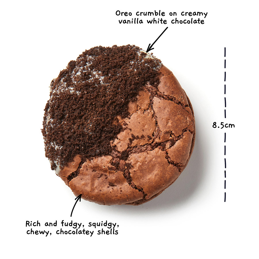 Image of an oreo brownio from above with the words Oreo crumble on creamy vanilla white chocolate. Rich and fudgy, squidgy, chewy, chocolately shells. There is a measurement line showing the width of the brownio to be 8.5 centimeters.
