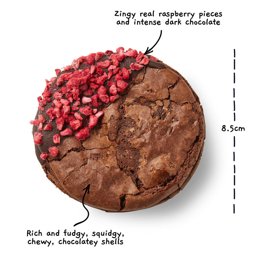 Image of a raspberry brownio from above with the words Zingy real raspberry pieces and intense dark chocolate. Rich and fudgy, squidgy, chewy, chocolately shells. There is a measurement line showing the width of the brownio to be 8.5 centimeters.