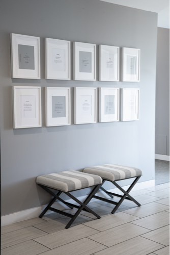 bench in hallway with pictures on wall