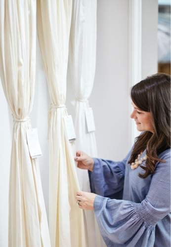 woman feeling boll and branch curtains